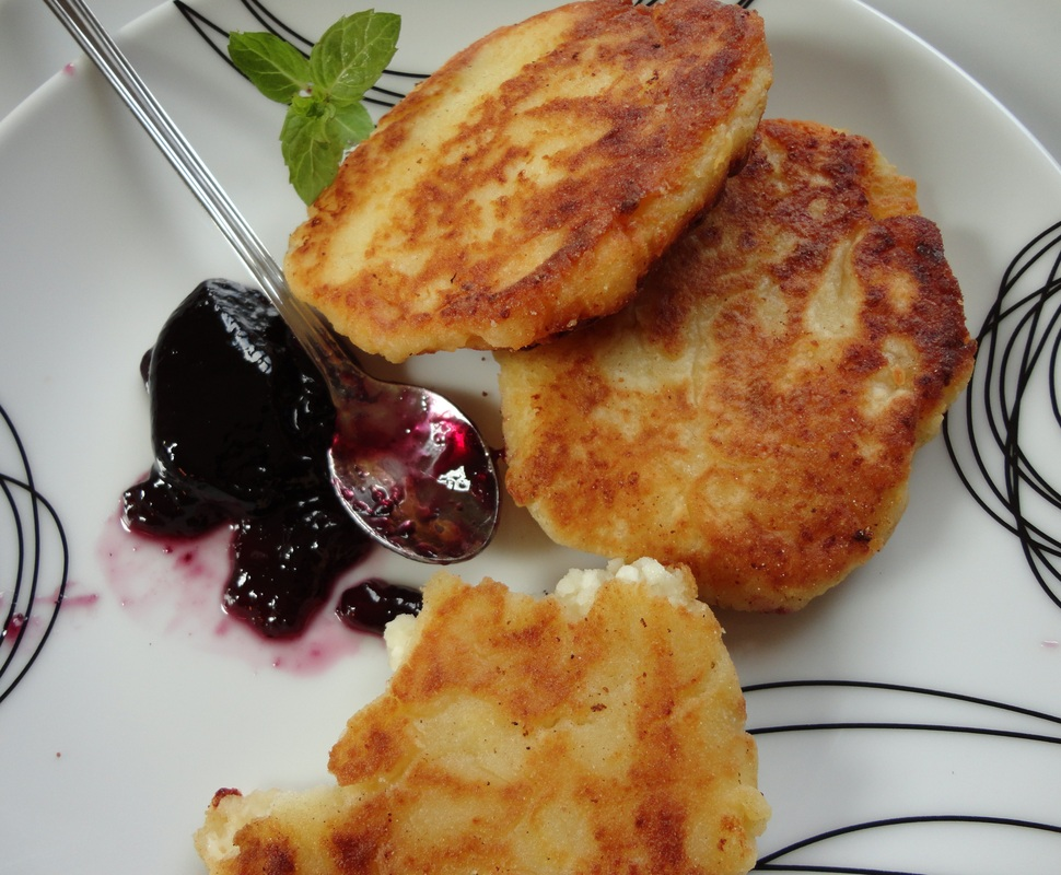 Curd cheese patties with some blueberry fruit spread